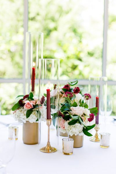 Trio Centerpiece With Taper Candles - 4 keys to hosting the perfect event