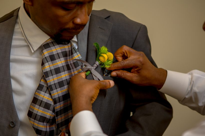 Yellow and gray boutonniere