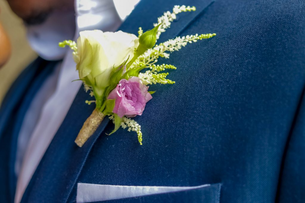 White and Orchid Boutonniere